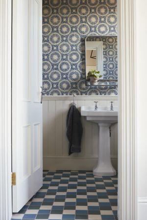 Bathroom,tiling, wallpaper,pendant light,wall mirror,sink,open shelf,towel hook