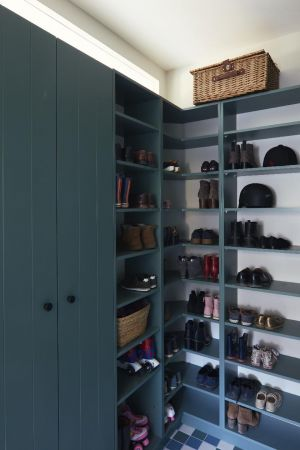 Hallway,storage,hooks,bare bulb light,tiling,timber panels,