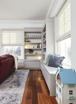 Living room,timber flooring,open shelves,window sea,cushions.lights