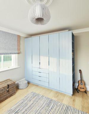Bedroom build in storage,blind,timber flooring,pendant light
