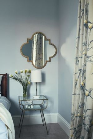 Bedroom glass side table,wall mirror,flowers,curtains