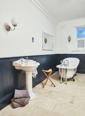 Bathroom,bath,sink,timber panels.lighting,wall mitrror,floor tiling